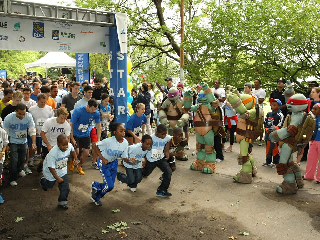 Ready, Set, Race!|These runners have their own personal Ninja Turtle cheering squad! Now that's inspiration.