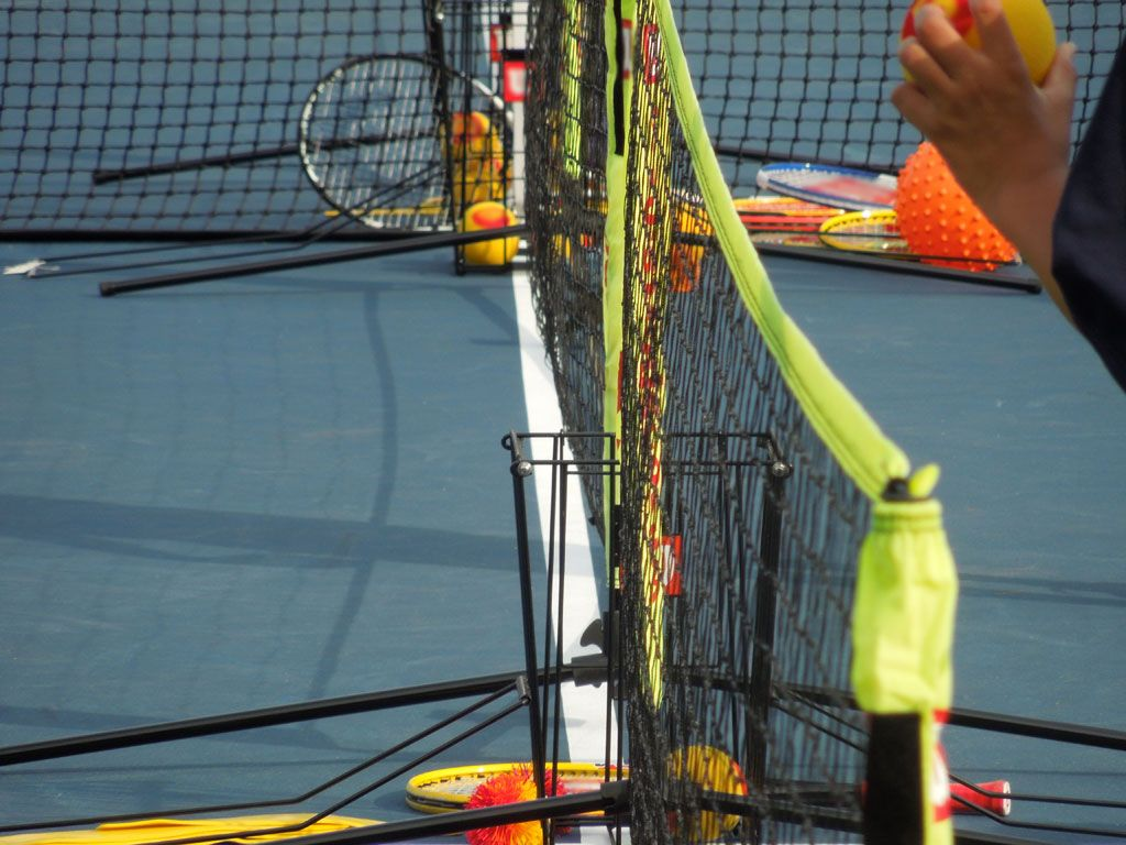 Colorful Gear|Who says tennis balls have to be green? There were all sorts of fun colors on the court.