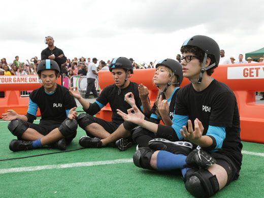 Zenning Out|The blue team takes a time out for some quiet meditation before they take to the course.