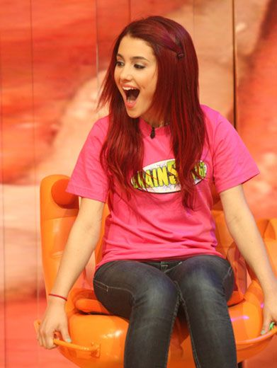 Handy Grande|Ariana Grande takes a high-fiving seat to see if her answer is right, or if it's sending her right down the brain drain.