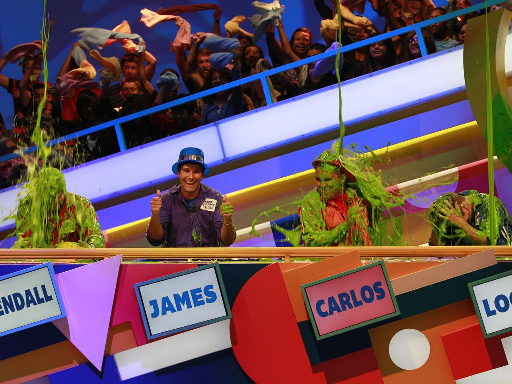 Everyone but James|James gives us the thumbs up as he knows he's not getting slimed.