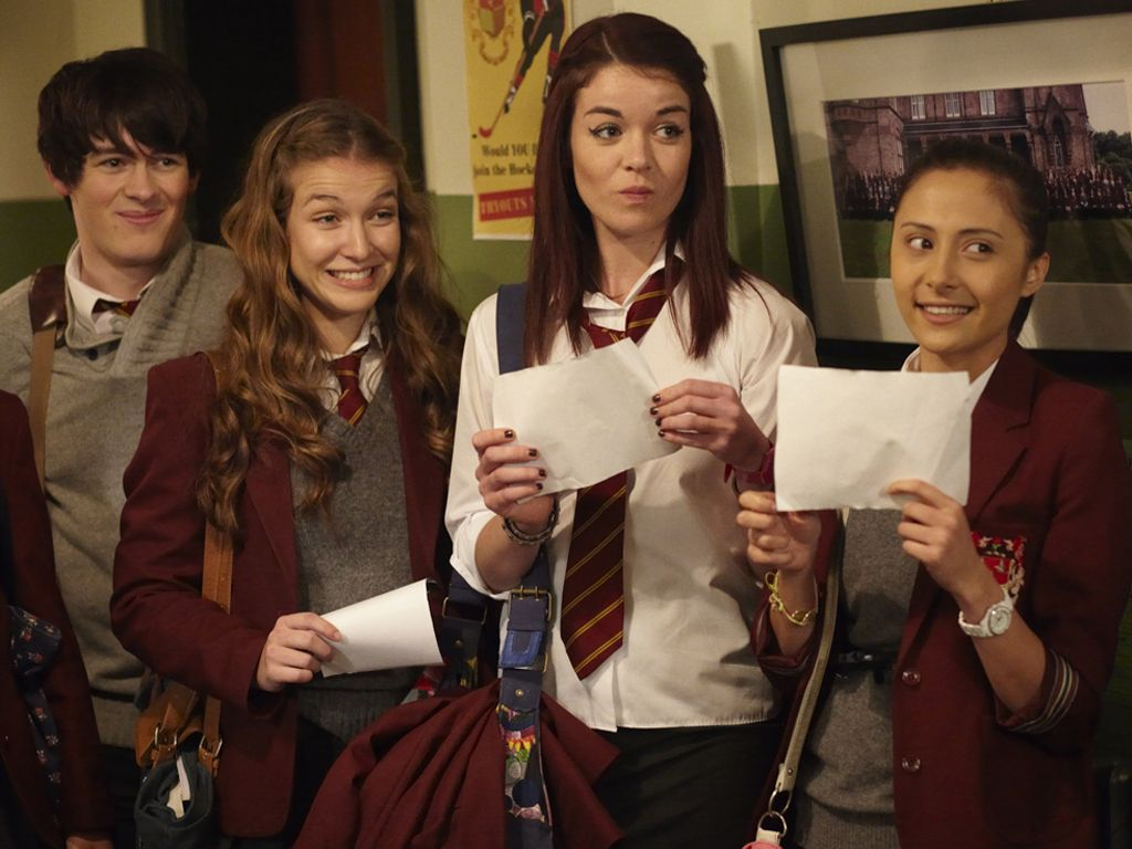 Passing Notes|The group looks like they've received some exciting news!