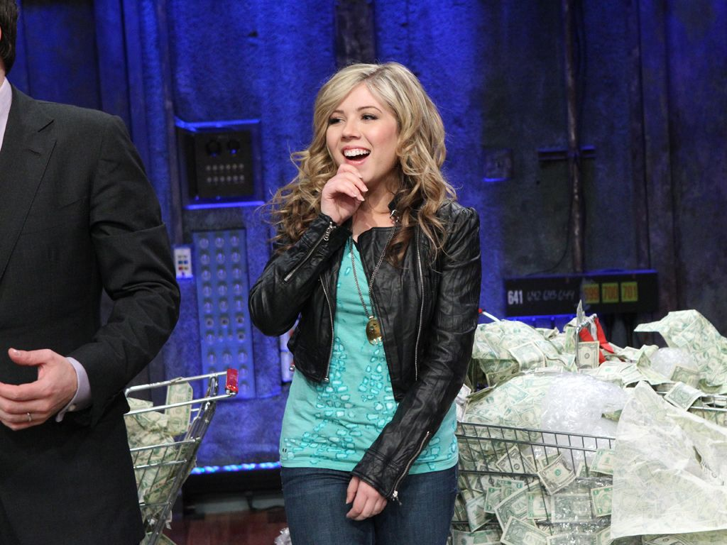 Joyous Jennette|We think all that cash is making Jennette giddy!