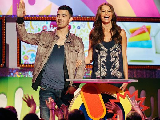 Get On With the Show, Joe|Sophia Vergara had to remind Joe Jonas to start reading his lines because he was too busy waving to screaming girls. We know, it's hard being such a stud-muffin!