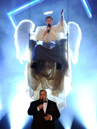 Who's that Angel?|Kevin James' angelic helper gets him from tuxin to crunkin in no time.