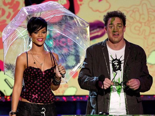 Green Shower|Rihanna's umbrella-ella-ella saves her... but not Brendan Frasier.